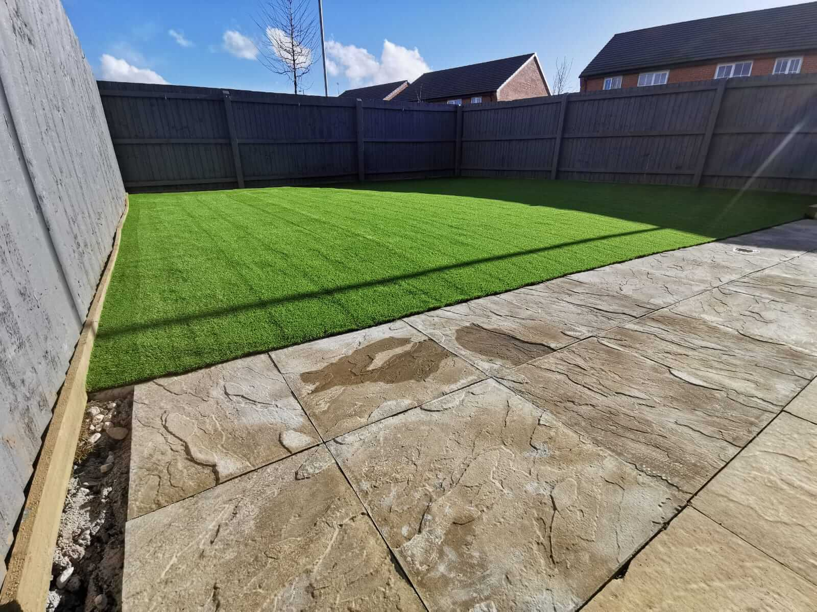 Large back garden with artificial grass installed