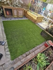 Back garden with artificial grass installed