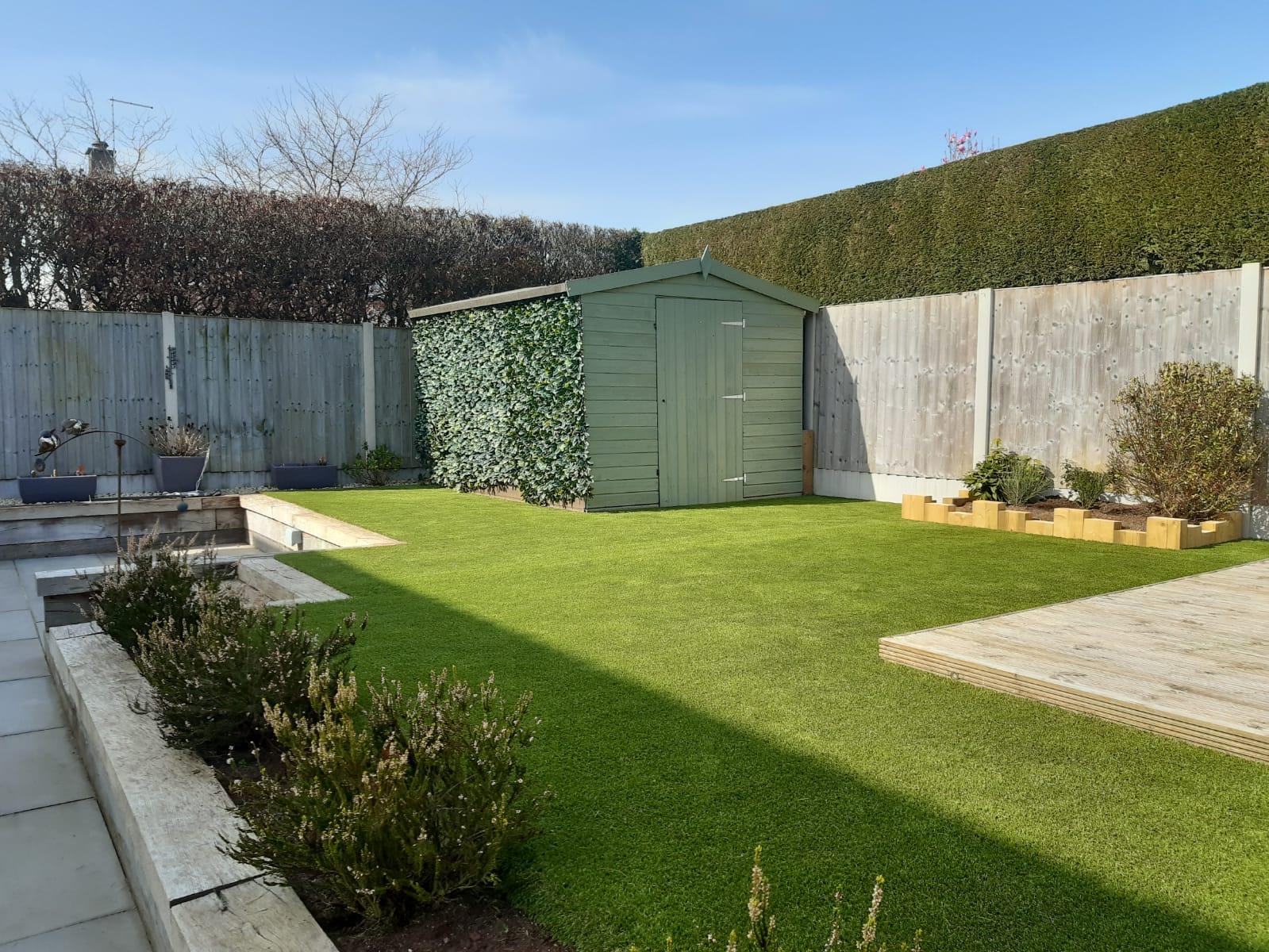 Artificial grass installed in garden for puppy.
