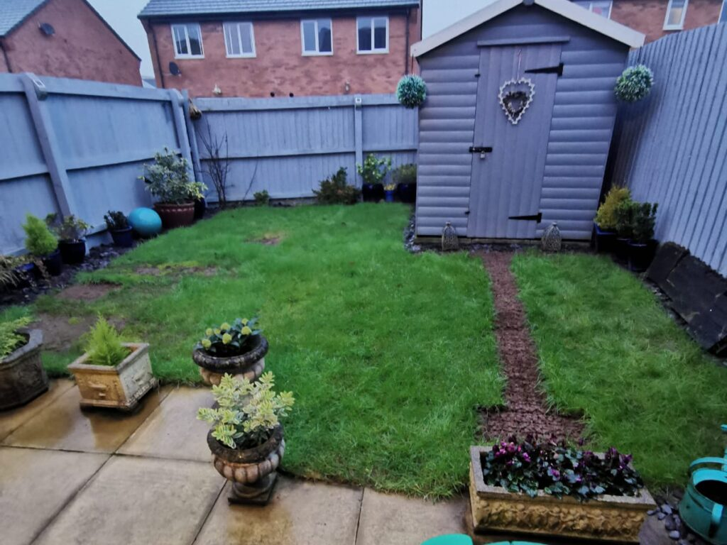 Before new build garden with overgrown grass.