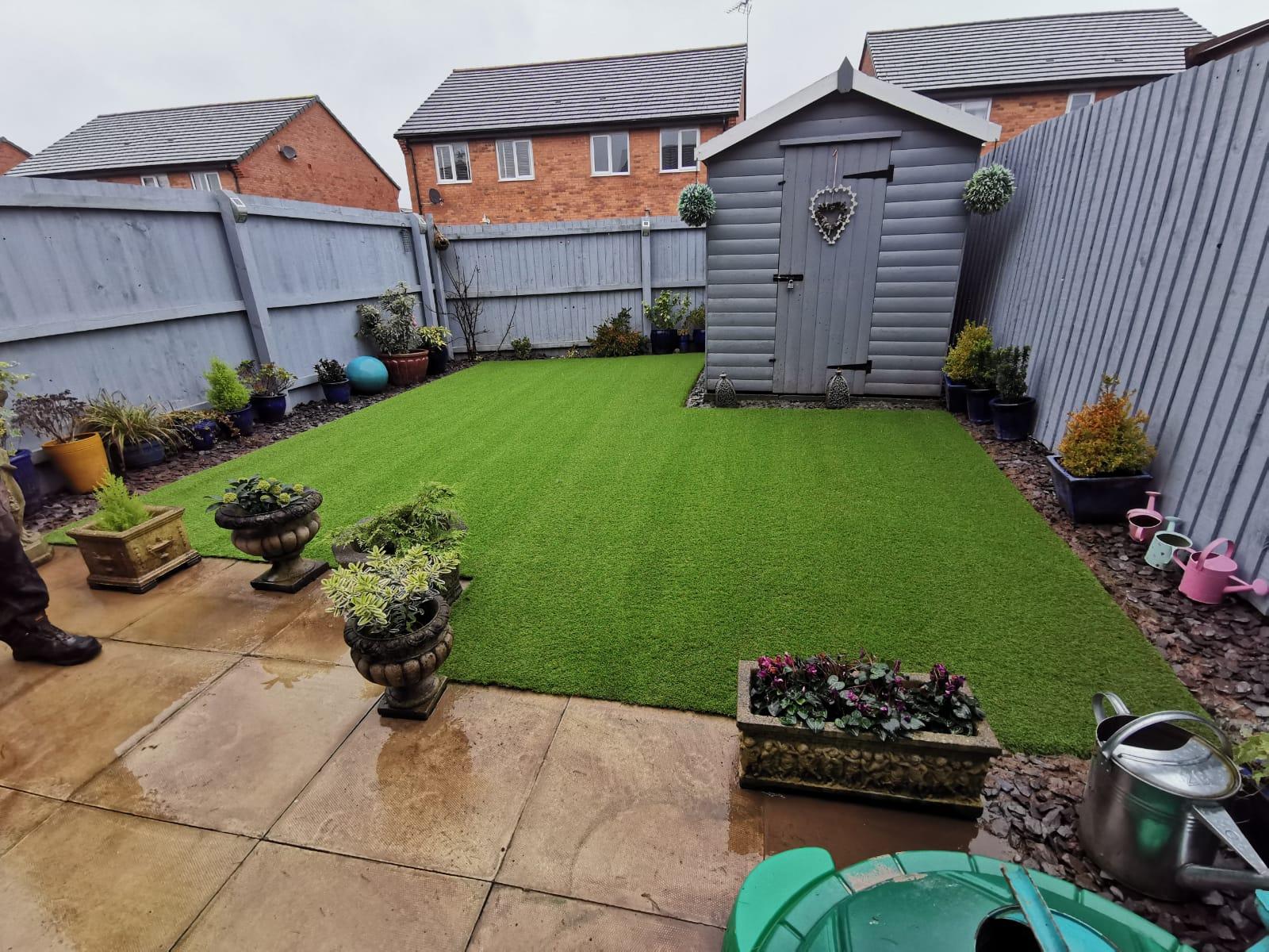 New build garden with artificial grass.